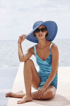 A sea-blue palette washes over this strapless feminine one-piece with a slimming secret.
