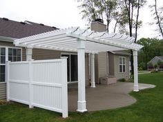 A pergola with added privacy wall is perfect for condo living to give your outdoor space some added coziness.
