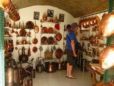 Copper artifacts, Loulé Market, Algarve, Portugal, via Flickr.