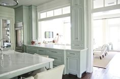love this...I love the style of the cabinetry and the white marble counter tops, the transom windows, the classic feel