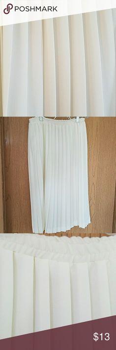 "Pleated Pretty Pleated Light cream in Color Skirt. Length 27"" Elastic waistline. Skirts Midi"