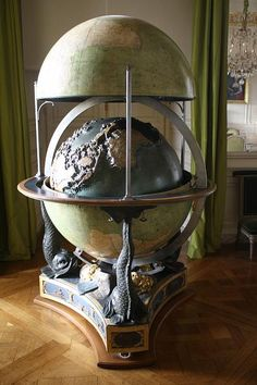 Terrestrial & celestial globe, commissioned from Edme Mentelle by King Louis XVI for the Dauphin's education in 1786. The first globe, moving & in relief, is inserted inside 2 hemispheric segments: the upper section shows the Old World & the lower one the New World. Mentelle's globe demonstrates how advanced these teaching tools were for their time. Its originality lies in a system of moveable political geography maps that can be screwed into small holes in the inner globe, (c) Yvan…