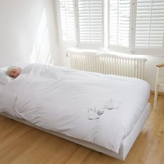 Snurk Bedding! Looks like you have left a bra/mens shirt/sleeping puppy on your bed = LOVE xoxo