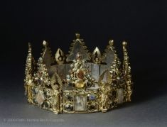 Long called the Crown of St. Louis and thought to have been made in Paris, the Crown of Liège, acquired by the Louvre in 1947, is now known to be a Mosan piece. Given by St. Louis, King of France, to the Dominican monastery in Liège.    3rd quarter of the 13th century Reliquary crown  Gilded silver, precious stones