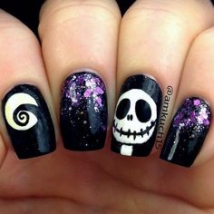 Skull Halloween Nail Art with a Bit of Purple Sequins. Halloween Nail Art Ideas. #nailart