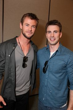 Chris Hemsworth and Chris Evans... I will never criticize my boyfriend for wearing his sunglasses on his shirt like this again!!