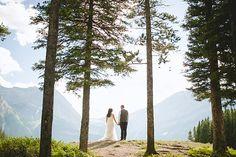Romantic outdoor wedding photo overlooking the Rocky Mountains