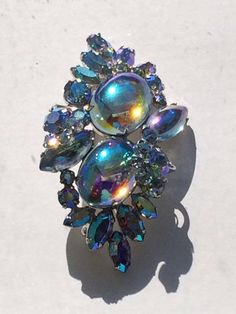 Signed vintage Sherman iridescent blue rhinestone brooch   eBay