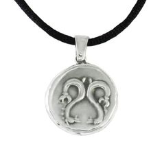 We created especially for you, a unique jewellery with Triton, who was a mythological deity of the seas in ancient Greece. The pendnat is inspired by the silver stater of Itanos, that depicts Triton on one side and two seahorses on the other. 375-350 B.C., Crete Diameter: 2,5cm Thickness: 0,3cm Silver 999°