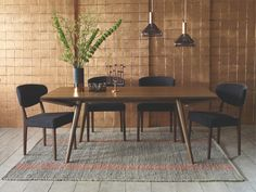 WING BROWNS Wood Walnut extending dining table - HabitatUK  Wing walnut extending dining table is a beautiful and sophisticated piece of furniture designed by Simon Pengelly for the Habitat Design Reunion project to celebrate our 50th birthday.