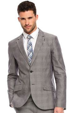 I think this looks sharp.  A gray suit is a good classic go to for a guy just like a navy and black one. Classy but current!