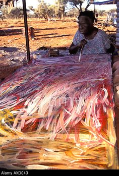 Emily Kame Kngwarreye famous Aboriginal artist painting one of her paintings at Utopia Central Australia Stock Photo