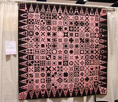 pink and black quilt from the Pacific International Quilt  Festival