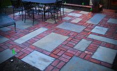Brick and Concrete Patio. We would stain the concrete slabs for less of a contrast.
