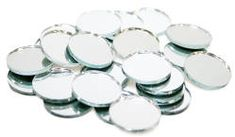 Glue 2 of these, back to back and insert a silver metallic cord for hanging. Fill the insides of the tree with these after putting on the lights, but before putting on the ornaments. The sparkle will be tripled.