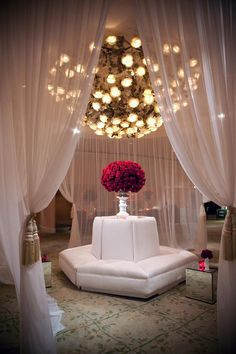 Fabulous drapery and vibrant floral arrangements add a touch of elegance to wedding reception venues.