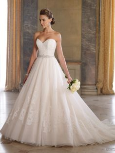 David Tutera Strapless tulle, organza and lace applique wedding dress ball gown with sweetheart neckline, corded lace applique bodice features intricately hand-beaded jeweled trim at natural waistline