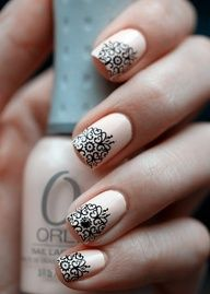 The detail in this nail design is absolutely stunning! White Nails with Elegant Black Pattern