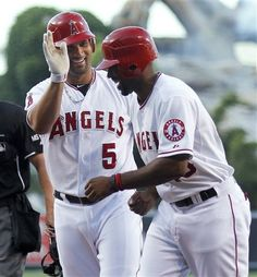 Game #69 6/19/12: Los Angeles Angels' Albert Pujols celebrates his three-run home run with Torii Hunter against the San Francisco Giants during the first inning of a baseball game in Anaheim, Calif., Tuesday, June 19, 2012.