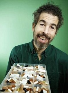 Quite the spread: Rosney, 54, takes 38 separate pills and supplements to treat his body and brain. He has an IQ of 192