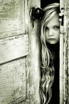 A beautiful black and white Portrait of a sweet kid behind the doors is just so adorable. The hairs of the girl are very well placed and the texture of an old door can be seen in black and white combination. Foto Portrait, Portrait Photography Tips, Hair Photography, Pinterest Photography, Portrait Ideas, Outdoor Photography, Amazing Photography, Scary Photography, Dental Photography
