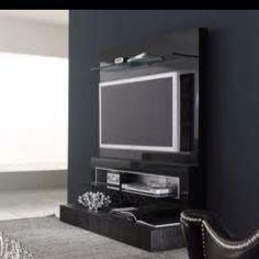 Tv stand-so its on the wall (kinda) and on a stand (kinda)