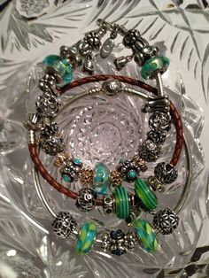 My blue, green and teal flower Pandora collection! Nicole