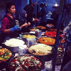 Traditional Indian food being served up at a street food stall in The Boiler House on Brick Lane, London