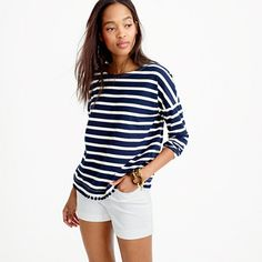 What's better than stripes? Stripes + pom-poms. This lightweight drop-shoulder style is a classic with a twist.