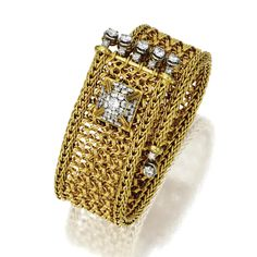 18 KARAT GOLD AND DIAMOND STRAP BRACELET, MARCHAK, PARIS, CIRCA 1950 The strap of woven gold decorated at the ends with fringes of round diamonds, the outer clasp designed as a diamond-set pyramid, the total diamond weight approximately 3.70 carats, length approximately 6½ inches, signed Marchak, Paris, numbered 43240.