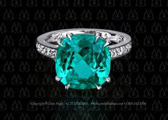 paraiba tourmaline ring with french cut diamonds - by Leon Mege    For more info go to: http://artofplatinum.com/vault/custom-paraiba-ring