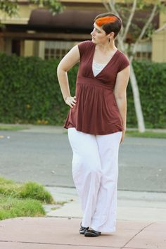 Wide leg white linen pants, terra-cotta empire waist blouse.