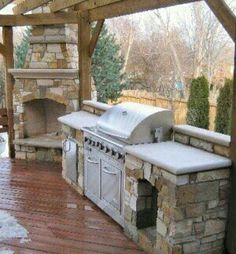 Love this stone grill island for the outdoor kitchen and the fireplace for the opposite corner