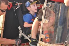 A Boy in a Wheelchair Gets Ready for a Memorable Balloon Ride Balloon Rides, Hot Air Balloon, Adaptive Sports, Find People, Make You Smile, Balloons, How To Memorize Things, Fun, Globes