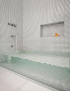 31. This see-through bath tub for all of your bubble bath needs