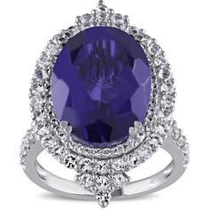 Miadora Sterling Silver Tanzanite Quartz and  Topaz Halo Cocktail Ring ($170) ❤ liked on Polyvore featuring jewelry, rings, tanzanite ring, sterling silver statement ring, topaz ring, oval stone ring and statement rings
