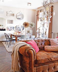 living / dining room /// vintage mirrors / distressed chesterfield / warm and bright palette
