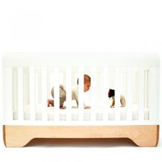 """Echo Crib  design: Kalon Studios  manufacture: Fabricated and finished by hand in Gardner, MA. Formerly known as """"the Chair Capital of the World"""", Gardner is a small community of highly skilled woodworkers. While the community used to support 5,000 craftspeople; it now employs fewer than 350. By locating its operations in Gardner, Kalon Studios is working to revitalize this community.  materials:"""