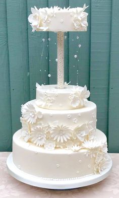 Bespoke wedding cake, unique wedding cake, white with flowers and extended topper
