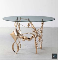 It's All About The Legs ----- L.A.-based David Wiseman's eye-catching bronze and glass collage side table is all about the legs - imaginatively sculpted ones that intermingle natural and abstract forms in a poetic dance.