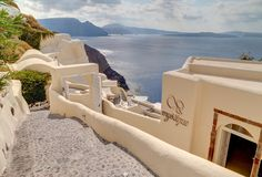 A cliff-top boutique hotel on the elegant island of Santorini, Mystique offers a…