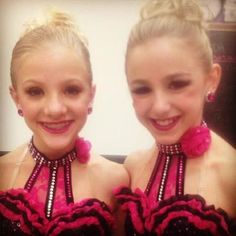 Chloe and Paige from Dance mom's wearing costumes from Crystalcoutureinc.com.