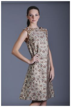 Persian fashion made modern with this all-season sleeveless dress embroidered with embellished shoulders of precious Aqiq and pearls for an eyecatching look  Explore more Persian fashions online at http://www.alangoo.com/kouroshfashion