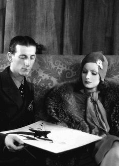 "vintagechampagnefever: "" Greta Garbo goes over costume sketches with MGM designer Adrian """