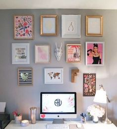 gallery art wall with posters, letters and an animal head