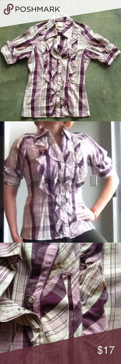 """Purple plaid collared blouse sz M Fun purple plaid blouse with snap buttons (all work) and ruffle detail down the front and on sleeves. The back also has a tie so that you can adjust the waist. Bust will accommodate a C-DD cup (I'm 32 DD and no pull between the buttons. Nothing wrong with it (dry cleaned then put away), I'm just kinda over the ruffle which is more girly than I'm into right now.  100% cotton. Armpit to bottom hem 16"""".  Offers welcome! Nolita Tops Button Down Shirts"""