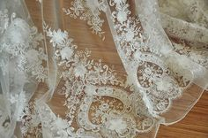 This gorgeous ivory 3D flower lace fabric to our lace fabric collection just at this early spring , special design from Korean customer for high end