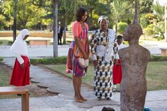 The First Lady and Salma Kikwete pause for a moment of silence while visiting the U.S. Embassy Bombing Memorial at the National Museum in Dar es Salaam, Tanzania.