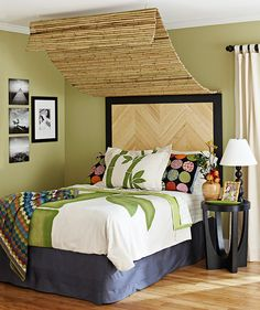 Drape bamboo reed fencing for a textured canopy. Screw one end of woven fence to the wall (above the headboard), then loop twine through the other end to hang from ceiling-mounted cup hooks.