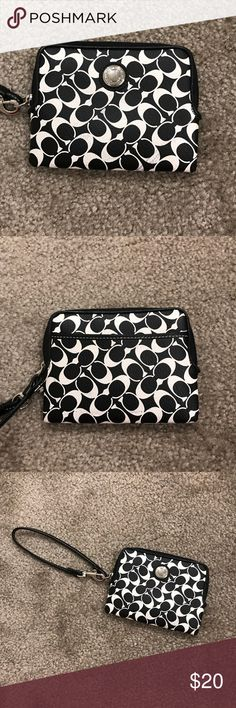 Coach Wristlet Black and white Coach wristlet, one pocket on the outside, blue lining on the inside, with one zippered pocket and 4 card slots, gently used see up close picture Coach Bags Clutches & Wristlets